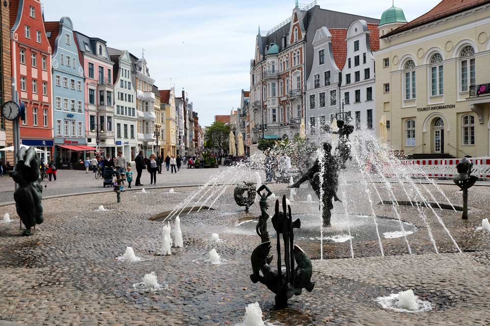 fountain and gabled buildings in cobblestone plaze in Rostock
