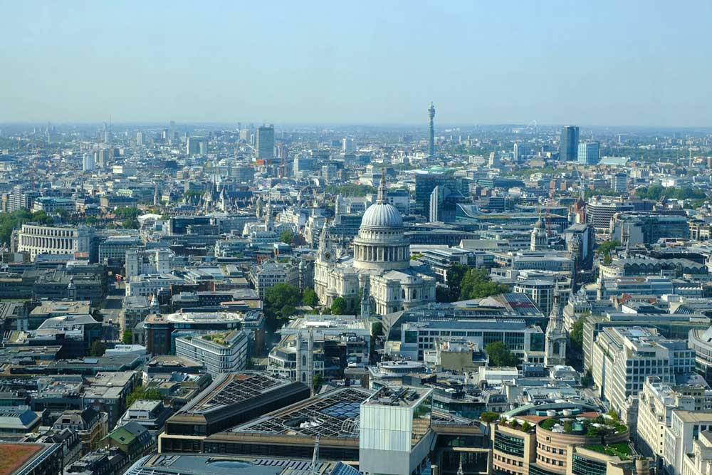 the dome of st pauls cathedral london and city streets from the sky garden