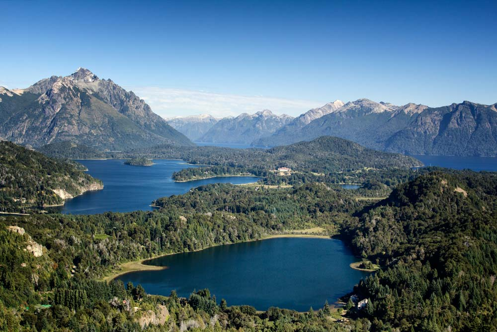 panoramic view of blue lakes and mountains in the lake district seen in 2 weeks in argentina