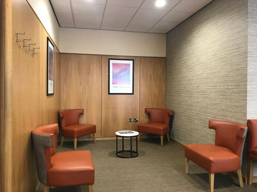 orange vinyl armchairs and table in lounge