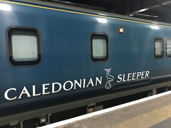 blue exterior of carriage of train considered in caledonian sleeper first class review