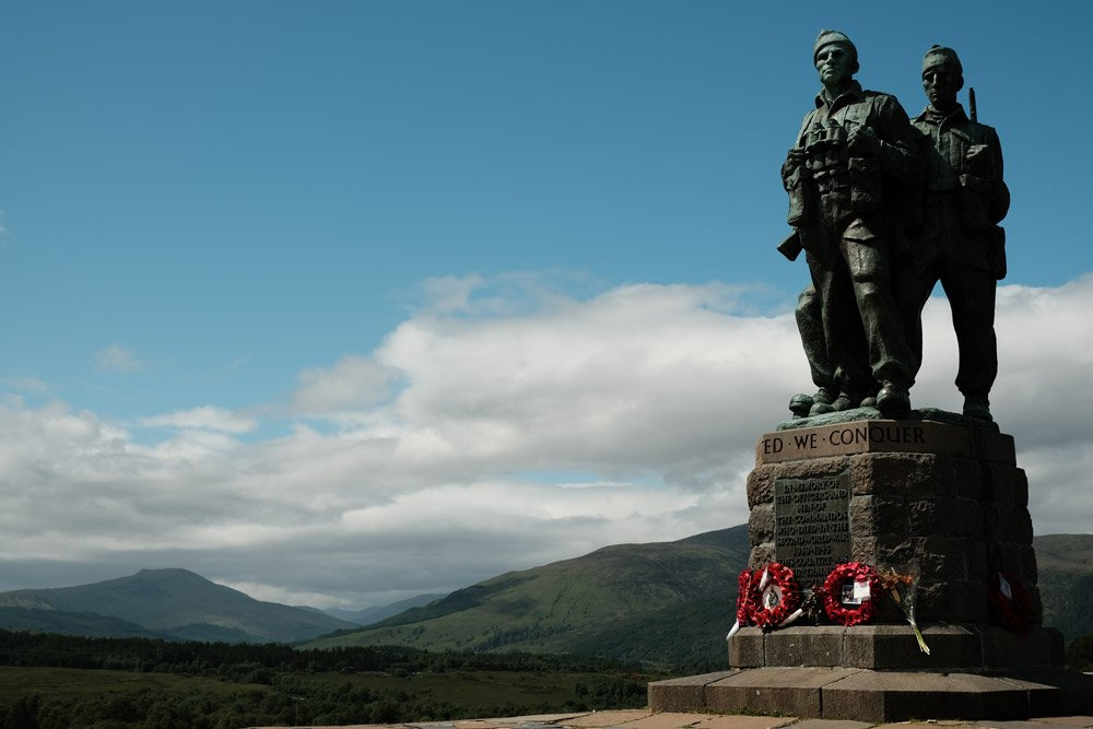 memorial statue with mountains in background