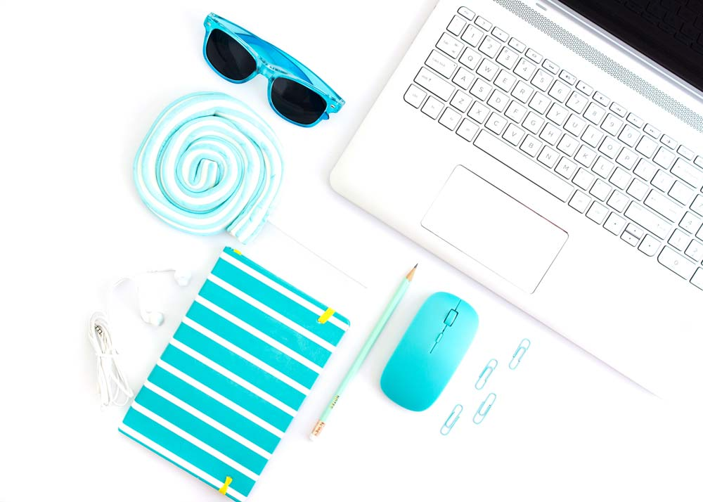computer with blue mouse and blue sunglasses