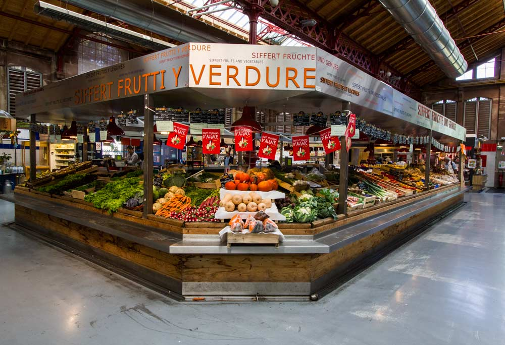 fruit and vegetable stall in covered market