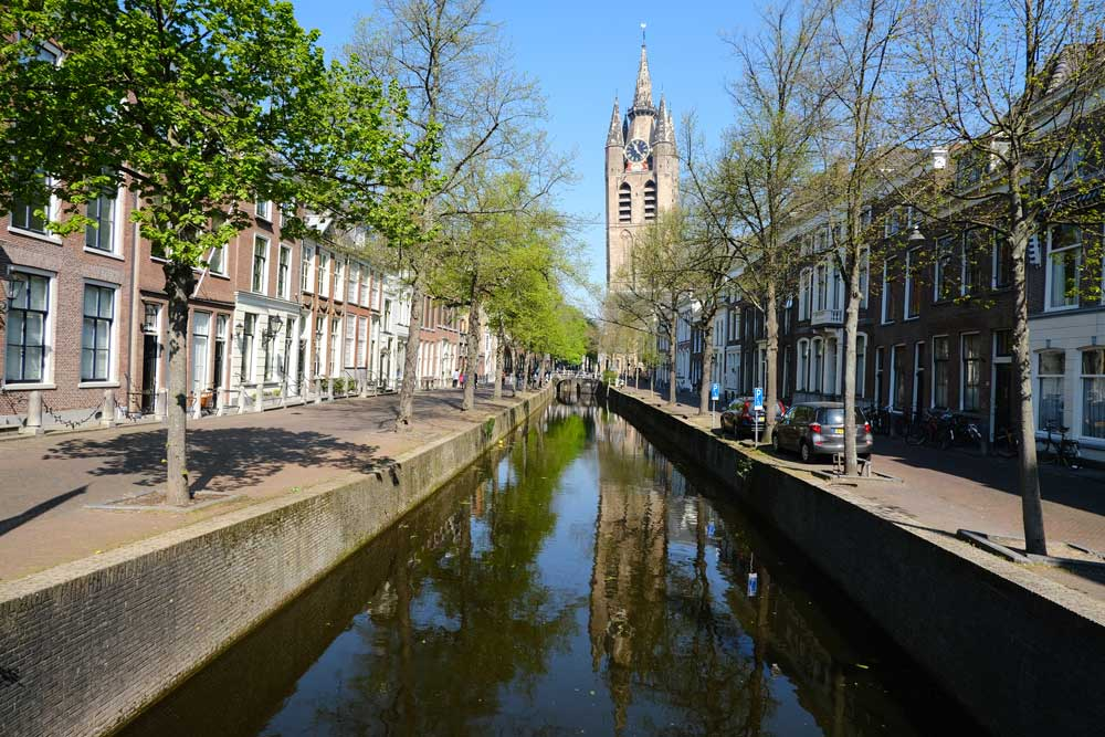 canal with buildings and church spire