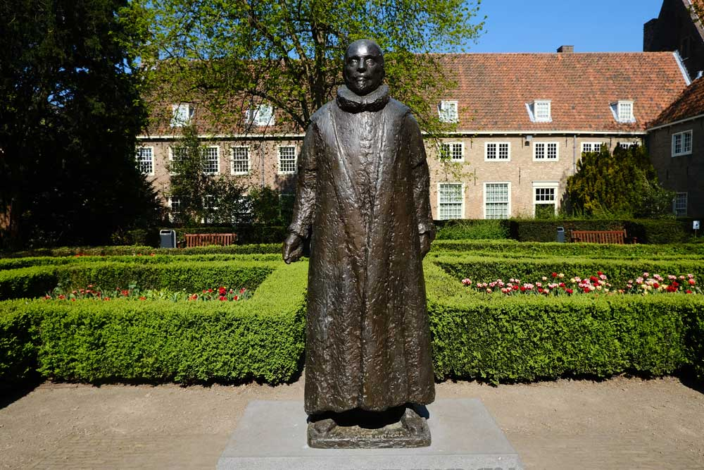 bronze statue in front of prisenhof museum one of the best things to see in delft netherlands