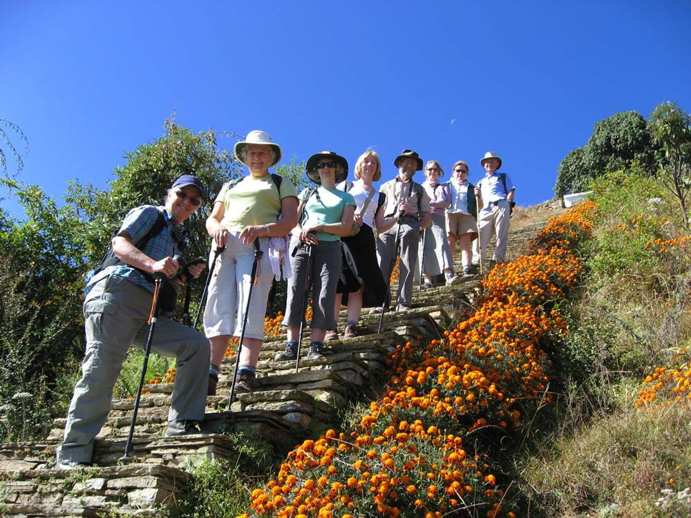 group of solo travellers standing on steps on a group tour which is a good option if you want to learn how to travel alone for the first time.