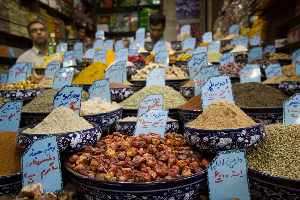 men standing behind spice stall
