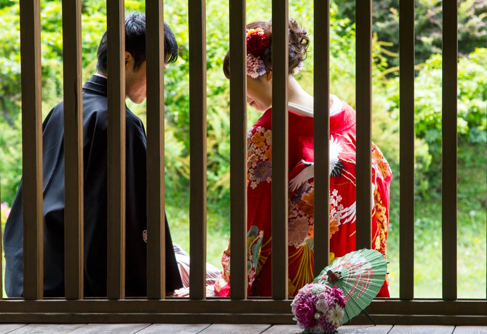 man and woman in japanese traditional dress