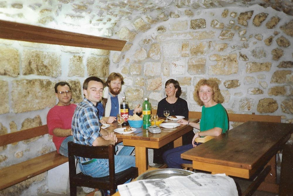 group of people eating sitting around table