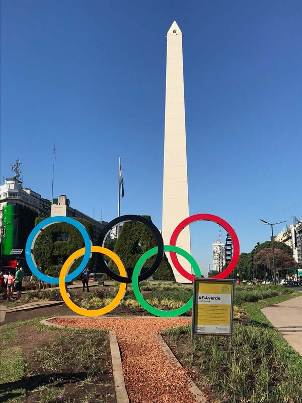 Obelisk behind coloured interlocked rings in downtown Buenos Aires