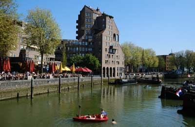 people in a boat in old harbour rotterdam