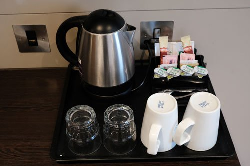tray with tea and coffee making equipment in hotel room