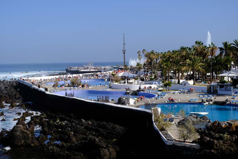 people enjoying water park by the sea in puerto de la cruz tenerife