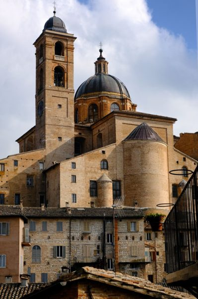dome and spire of cathedral in renaissance town of urbino in italy