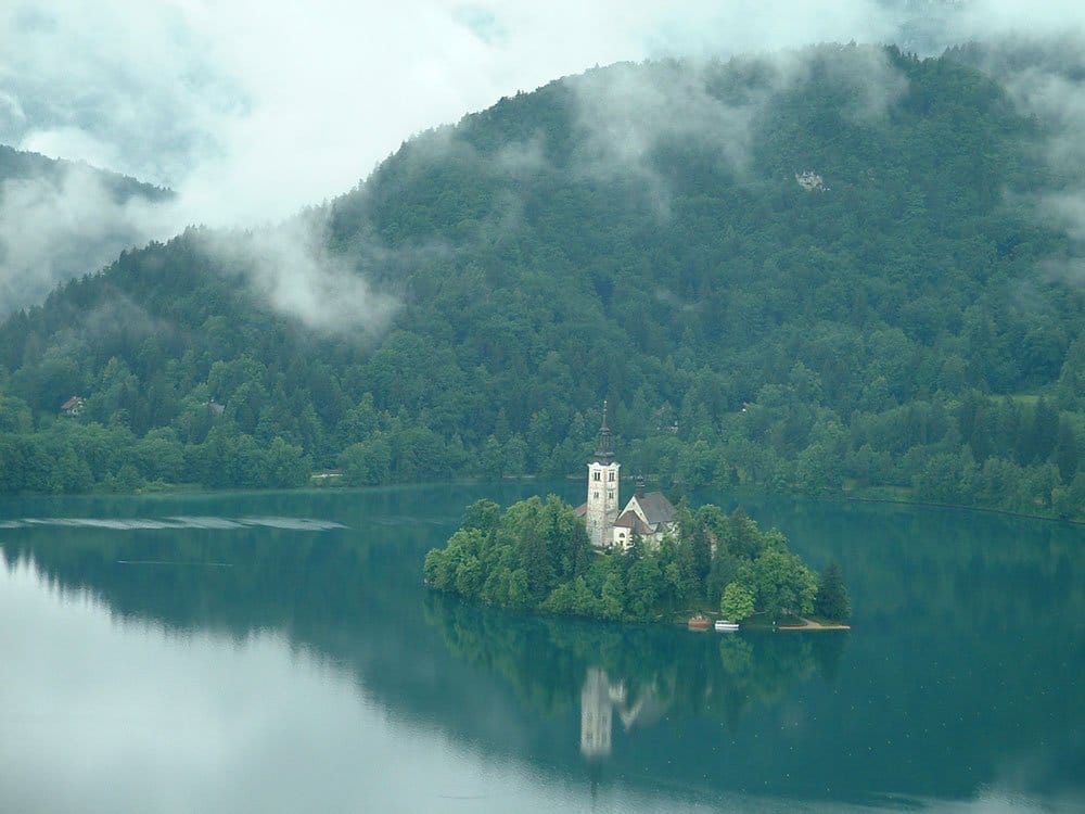 church ion island in the middle of lake bled slovenia