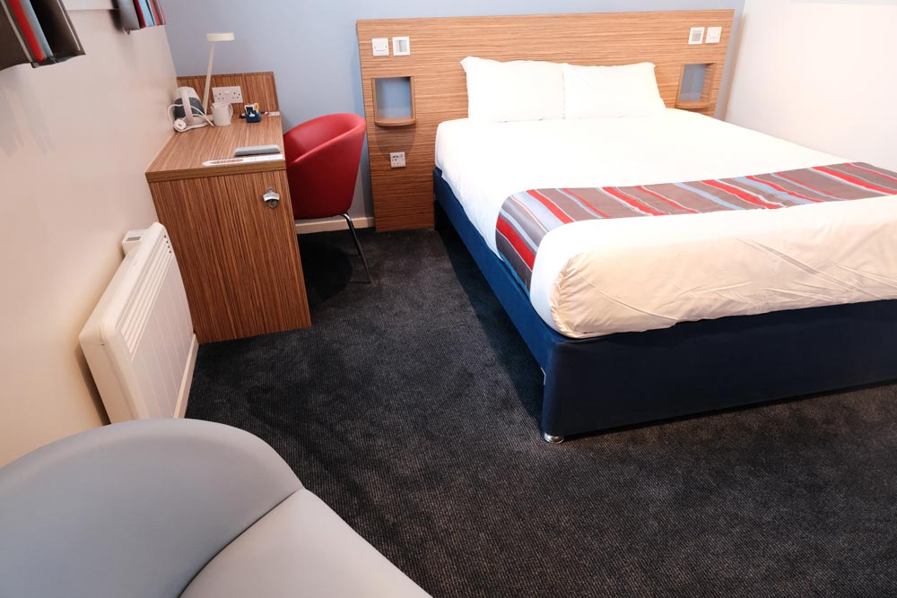 room at Travelodge Inverness City Centre with bed and desk which may be the best cheap hotel in inverness