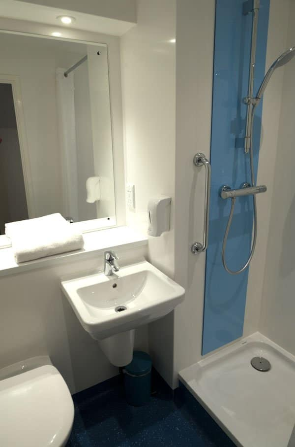 white bathroom with shower cubicle and sink