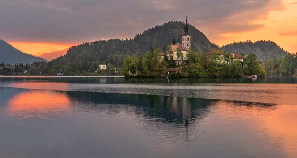 photographing this sunrise over the lake is one of the best things to do in lake bled slovenia