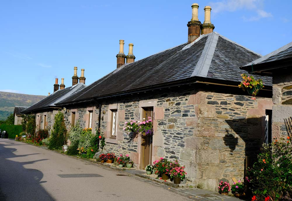 row of pretty cottages under blue sky