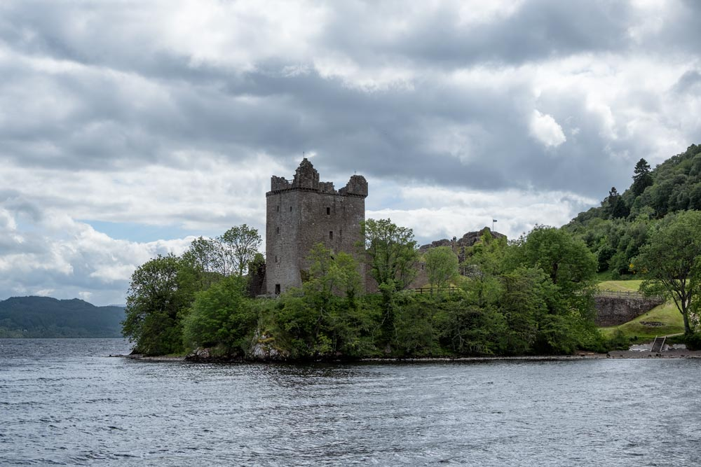 ruins of old castle by lake