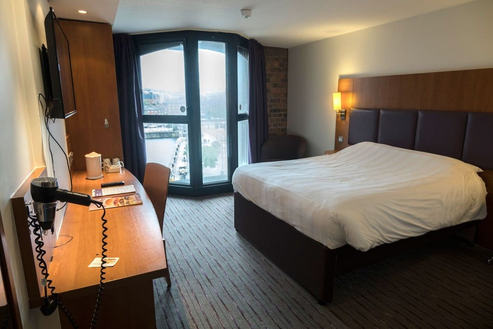 hotel room with king-size bed and desk