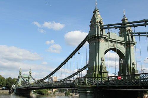green iron bridge over river