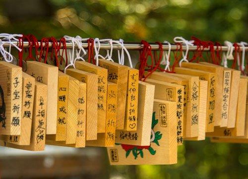 wooden prayer blocks hanging on a rail