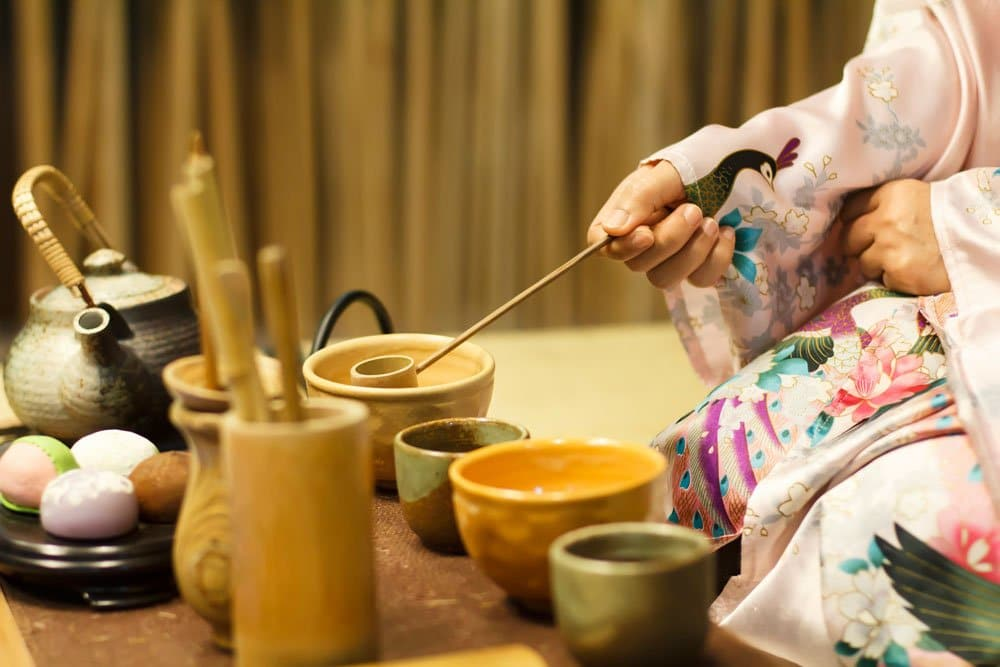 woman in kimono conducting a tea ceremony which is one of the things that Japan is famous for