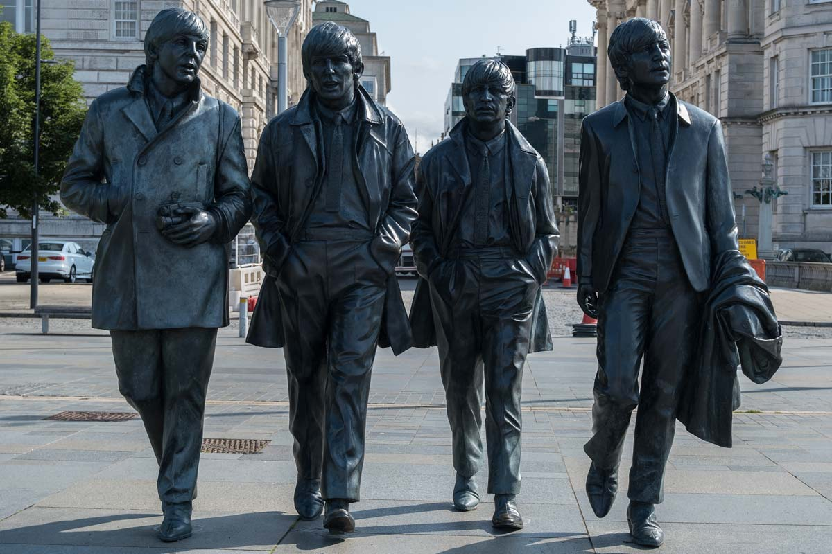 iron statue of the beatles in liverpool england