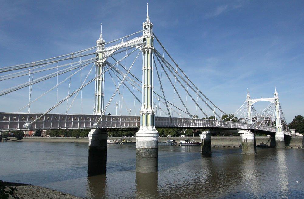 pretty white suspension bridge over river in london