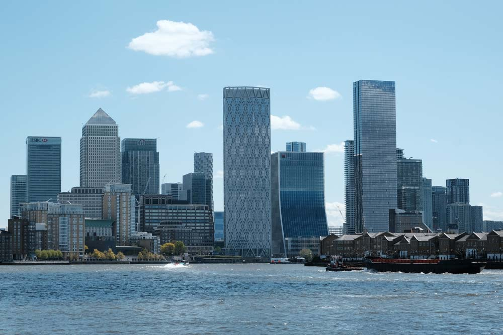 skyscrapers of canary wharf london by river