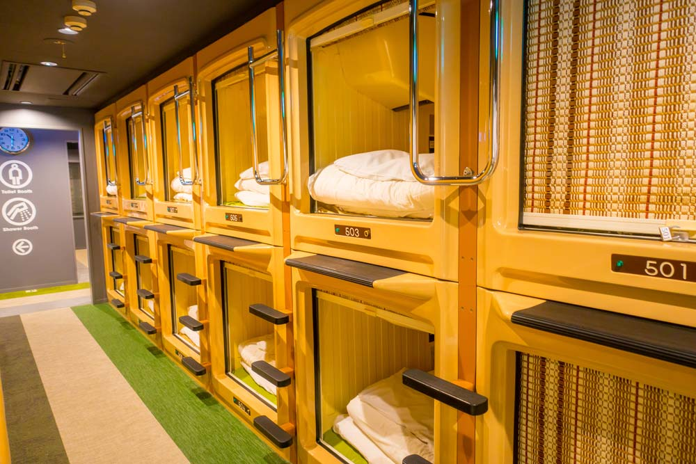 row of pods in a capsule hotel in japan