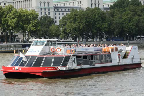 small cruise boat on the river thames in london