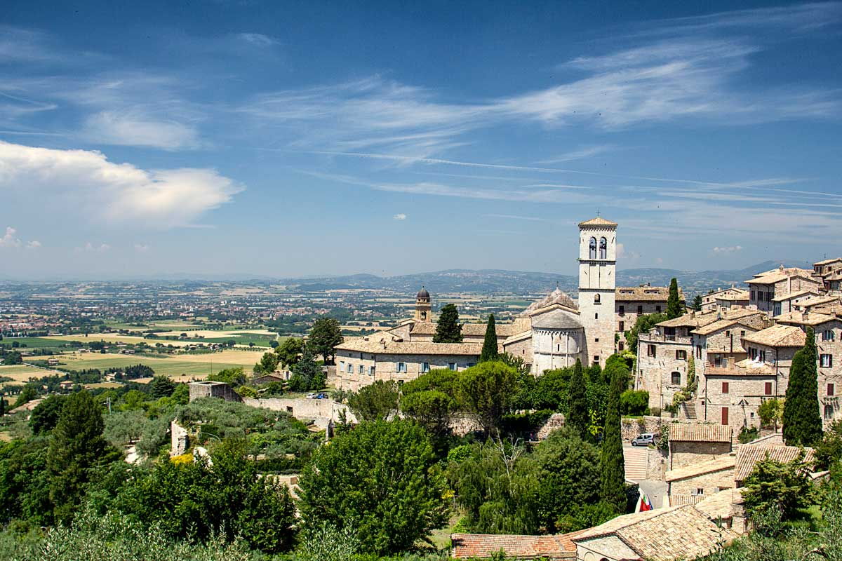 medieval town set amongst rolling countryside in italy