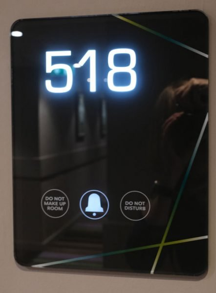 illuminated hotel room sign with the number 518