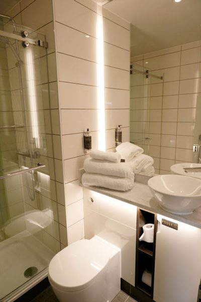 hotel bathroom with white toilet and sink unit