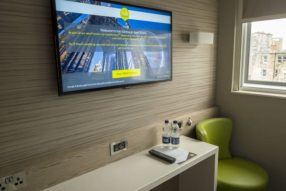 desk with tv on wall above in hub by premier inn review