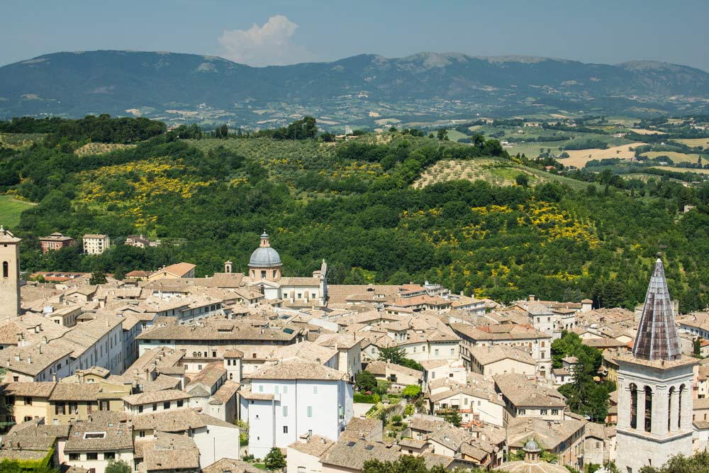 italian medieval town set amongst rolling countryside