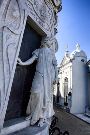 ornate marble tomb with statue of young girl