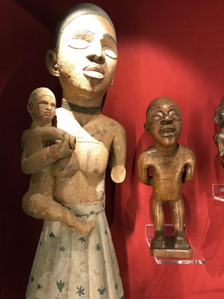 african sculptures displayed in a case