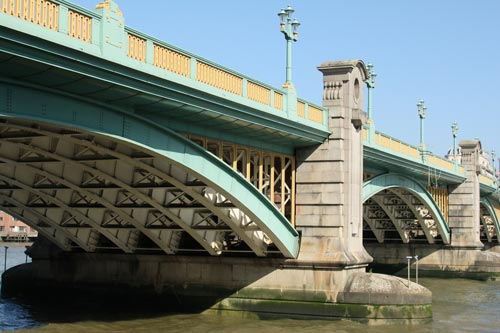 side view of yellow and green bridge in london