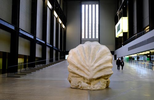 large sculpture of shell in large entrance hall to art gallery