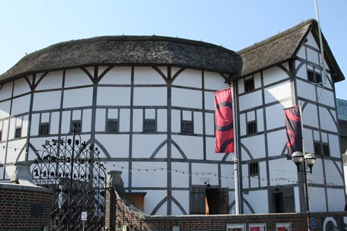 circular black and white theatre with thatch roof
