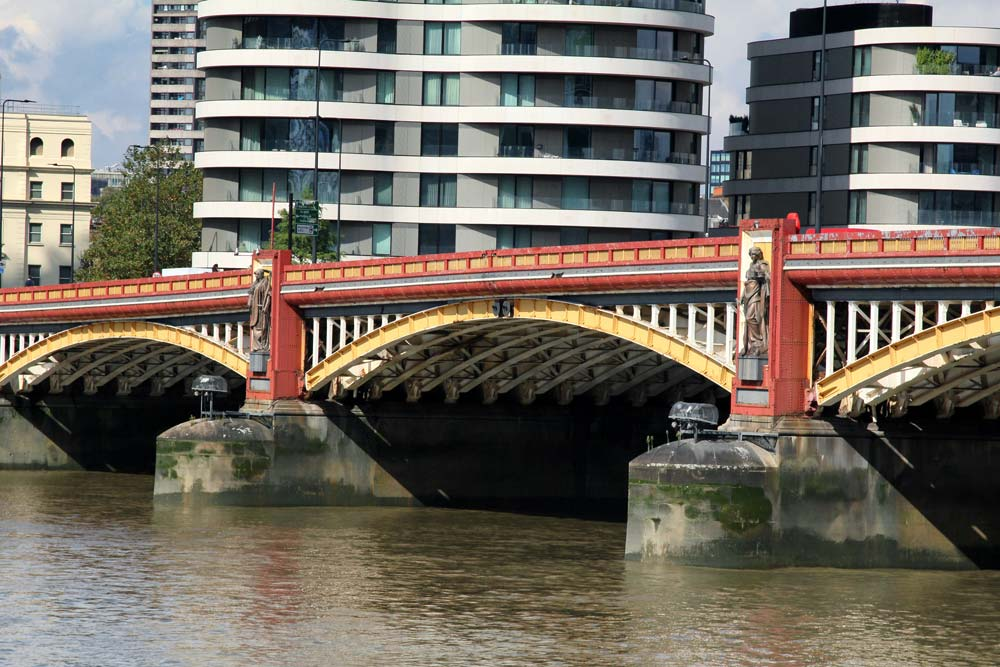 red and yellow river bridge in london studded with giant sculptures